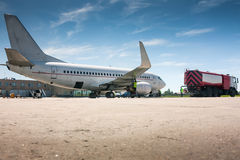 Refueling aircraft on the airport apron. Refueling aircraft at a small airport Stock Images
