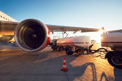 Refueling of the airplane. Amazing sunset at the airport. Refueling of the airplane before flight royalty free stock photo