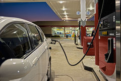 Refueling Automobile At Gas Station Convenience Store. A car gets a fill up at a gas station convenience store stock photography