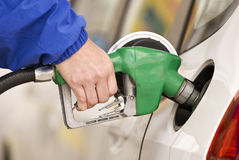 Refueling Automobile With Gasoline Pump Nozzle Stock Images