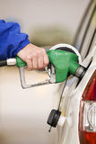 Refueling Automobile With Nozzle of Gasoline Pump Stock Image
