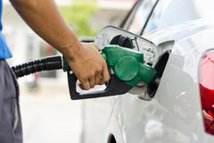 Refueling Car. With Gasoline Pump Nozzle, Selective Focus on pump nozzle Royalty Free Stock Photo