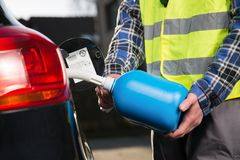 Refueling a car with a canister Royalty Free Stock Photos