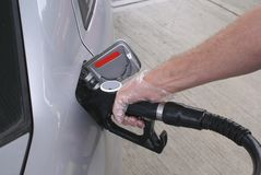 Refueling a car with diesel or petrol Stock Photos