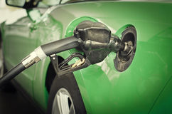 Refueling car with gas petrol green eco style royalty free stock photo