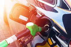 Refuelling the car at a gas station fuel pump. Man driver hand refilling and pumping gasoline oil the car with fuel at he refuel s stock image