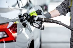 Refueling car with gasoline stock image