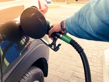 Refueling car on a petrol station. Concept of a fuel price change stock photography