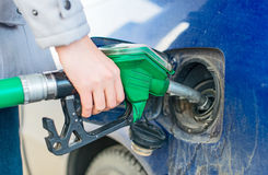 Refueling dirty blue car. Stock Photo