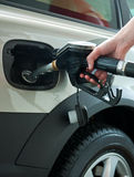Refueling gas in petrol station stock images