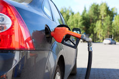 Refueling nozzle in the car Royalty Free Stock Photo