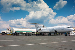 Refueling plane at a airport. Refueling plane at a small airport stock photography