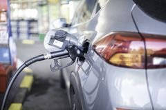 Pumping petrol diesel fuel in car at gas station royalty free stock photos
