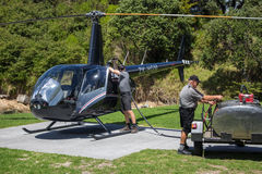 Refueling a Robinson R44 Raven II helicopter. Royalty Free Stock Photos