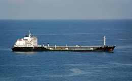 Refueling tanker anchored in port Stock Images