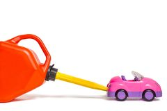 Refueling toy car with plastic gas tank Royalty Free Stock Image