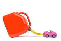 Refueling toy car with plastic gas tank. Comic concept features high prices, pollution etc Royalty Free Stock Photos
