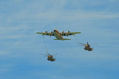 Refueller C-130 during refuelling operation Stock Image