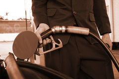 Refuelling. Duotone Image Of A Business Man Filling Up At Fuel Station Stock Photography