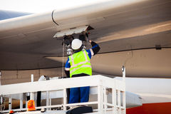 Refuelling the aircraft Royalty Free Stock Image