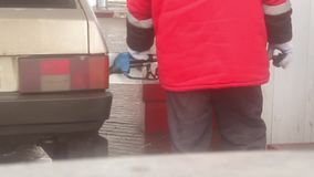 Refuelling the car on the Oil Market. Men opening car tank cap at petrol station stock footage