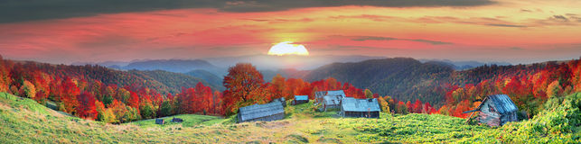 Refuge in autumn mountains. High in the mountains located Gutsulschiny tract with ancient village of shepherds, where shepherds live in the summer, cows and Stock Image