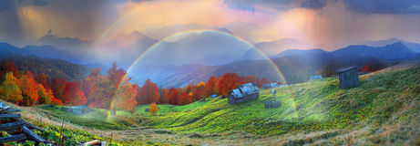 Refuge in autumn mountains. High in the mountains located Huzulschyna tract with ancient village of shepherds, where shepherds live in the summer, cows and Royalty Free Stock Photo