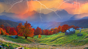 Refuge in autumn mountains. High in the mountains located Huzulschyna tract with ancient village of shepherds, where shepherds live in the summer, cows and Royalty Free Stock Images