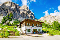 Refuge and beautiful mountains, Dolomites, Italy. Refuge on the background of beautiful mountains, Averau-Nuvolau group, Dolomites Mountains, Italy Royalty Free Stock Photo