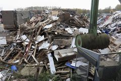 Refuge garbage rubbish dump site showing many wooden objects smashed by metal spike ball royalty free stock photography