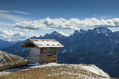 Refuge in high mountains. Refuge in the high mountains in South Tyrol on a sunny day with clouds Stock Photo