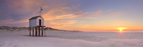 Refuge hut on Terschelling in The Netherlands at sunset Stock Photo
