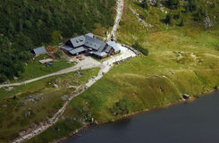 Refuge and lake in Karkonosze mountains. Poland Royalty Free Stock Photo