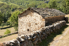 Refuge for livestock. Stone refuge with slate roof for livestock at high altitude typical of northern Spain Royalty Free Stock Images