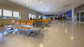 Refuge sur le terminal pour passagers d'aéroport Images libres de droits