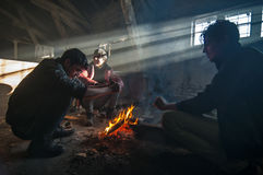 Refugee. Belgrade, Serbia- december 11. 2016: About 1,000 migrants find shelter from rain and cold weather in an abandoned warehouse behind the main railway Stock Photography