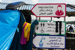 Refugee camp in Greece. Signs for water and medical  services on March 17, 2015 in the refugee camp of Eidomeni, Greece. For several weeks, more than 10.000 Royalty Free Stock Image