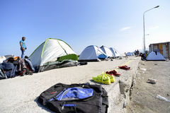 Refugee camp Lesvos Greece. Lesvos, Greece- October 05, 2015. Refugee migrants, arrived on Lesvos in inflatable dinghy boats, they stay in refugee camps waiting stock images