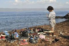 Refugee child at beach Lesvos Greece royalty free stock photo