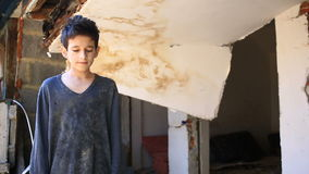 Refugee children against the background of bombed houses. War, earthquake, fire stock video