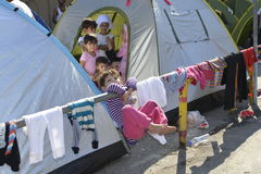 Refugee children in camp Lesvos Greece. Lesvos, Greece- October 05, 2015. Refugee migrants, arrived on Lesvos in inflatable dinghy boats, they stay in refugee stock image