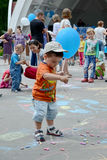 Refugee Day observed in Kharkov, Ukraine. KHARKOV, UKRAINE - 20 JUNE 2015: World Refugee Day observed in Kharkov, Ukraine. A little boy with a blue baloon Royalty Free Stock Images