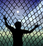 Refugee. Destitute person behind the fence in the refugee camp longing for liberty and peace royalty free illustration