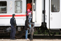 Refugee family getting off train Royalty Free Stock Image