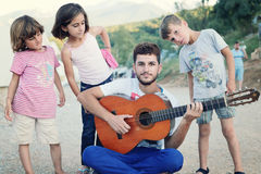 Refugee group singing stock images