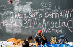 Refugee messages on a wall at the Keleti Train station in Budape. BUDAPEST, HUNGARY - SEPTEMBER 04: Syrian refugees demand help from Germany written on a wall at stock photo