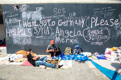 Refugee messages on a wall at the Keleti Train station in Budapest. BUDAPEST, HUNGARY - SEPTEMBER 04: Syrian refugees demand help from Germany written on a wall stock image