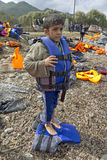 Refugee migrants, arrived on Lesvos. Lesvos, Greece- October 12, 2015, 2015. Refugee migrants, arrived on Lesvos in inflatable dinghy boats, they stay in refugee royalty free stock image