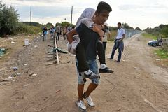Refugee. Syrians refugees walking on the tracks across the border, Serbia, Hungary Stock Photography