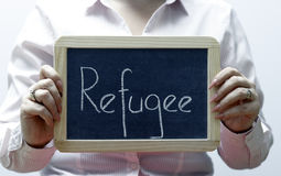 Refugee word written on blackboard/chalckboard Stock Photos